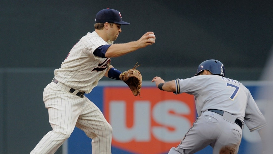 Minnesota Twins' Brian Dozier, left, beats Milwaukee Brewers' Norichika Aoki, right, to the bag to get the force-out at second base during the first inning of a baseball game on Wednesday, May 29, 2013, in Minneapolis. Minnesota won 4-1. (AP Photo/Tom Olmscheid)