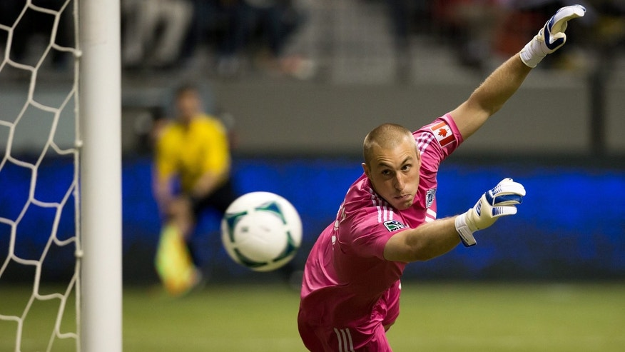 Vancouver Whitecaps goalkeeper Brad Knighton allows a goal to Montreal Impact's Felipe Martins during the second half in the Canadian Championship soccer game in Vancouver, British Columbia, on Wednesday, May 29, 2013. (AP Photo/The Canadian Press, Darryl Dyck)