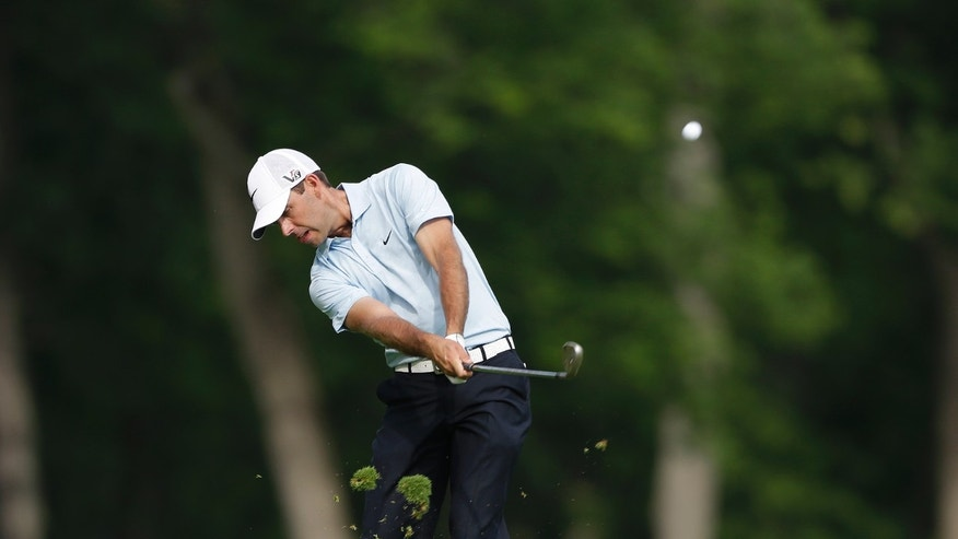 Charl Schwartzel, of South Africa, hits from the 13th fairway during the first round of the Memorial golf tournament  Thursday, May 30, 2013, in Dublin, Ohio. (AP Photo/Darron Cummings)