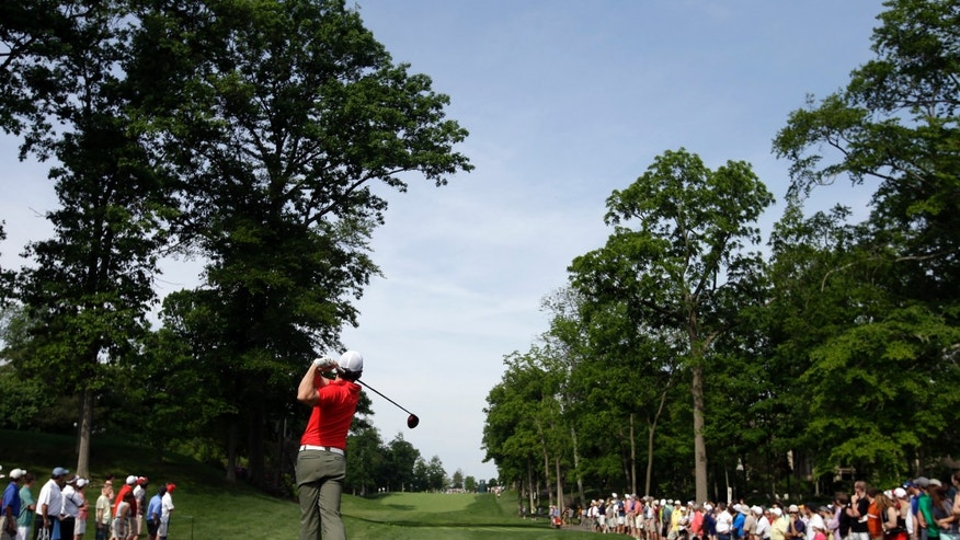 Rory McIlroy, of Northern Ireland, tees off the 15th hole during the first round of the Memorial golf tournament  Thursday, May 30, 2013, in Dublin, Ohio. (AP Photo/Darron Cummings)