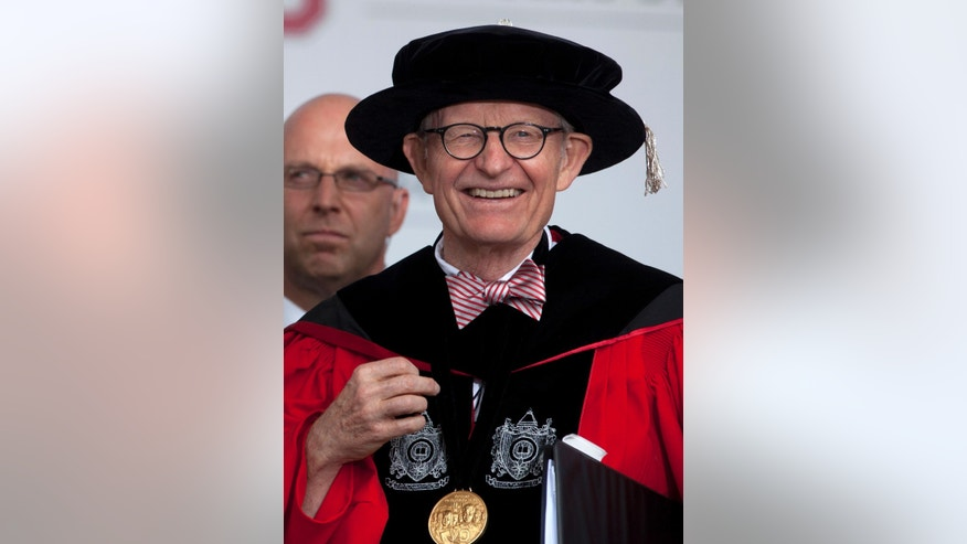 "This photo made Sunday, May 5, 2013, shows Ohio State president E. Gordon Gee during the Ohio State University spring commencement in Columbus, Ohio. Gee told a university committee last December that Notre Dame wasn't invited to join the Big Ten because they're not good partners while also jokingly saying that ""those damn Catholics"" can't be trusted. (AP Photo/Carolyn Kaster)"