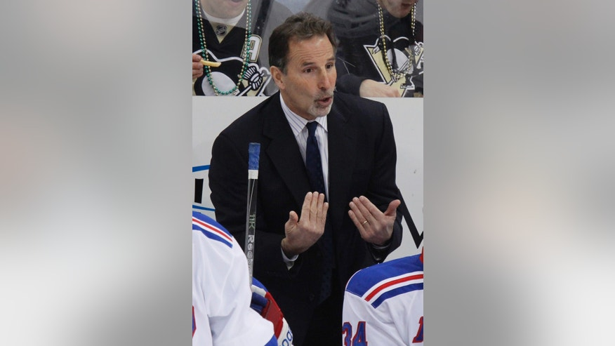 FILE - In this Feb. 21, 2012 file photo, New York Rangers coach John Tortorella gives instructions in the first period of an NHL hockey game against the Pittsburgh Penguins in Pittsburgh. The Rangers have fired coach Tortorella, Wednesday, May 29, 2013, four days after New York was eliminated from the Stanley Cup playoffs. (AP Photo/Gene J. Puskar, File)