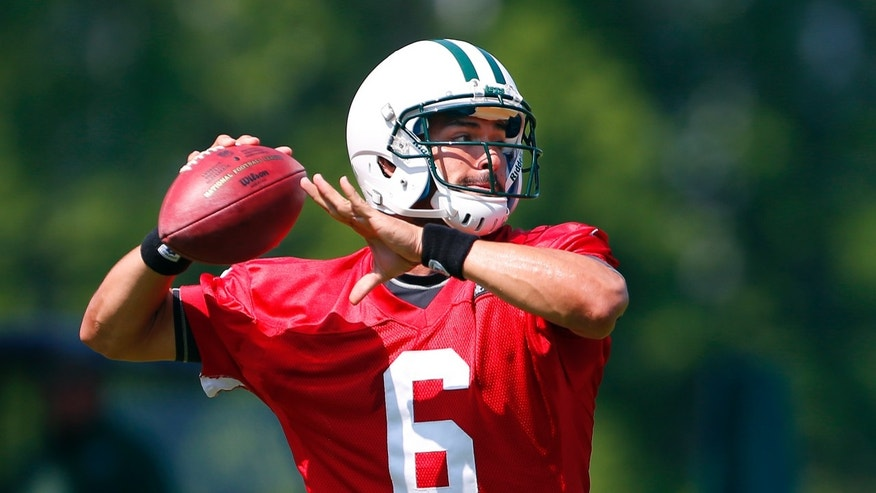 New York Jets quarterback quarterback Mark Sanchez throws a pass during NFL football practice in Florham Park, N.J., Thursday, May 30, 2013. (AP Photo/Rich Schultz)