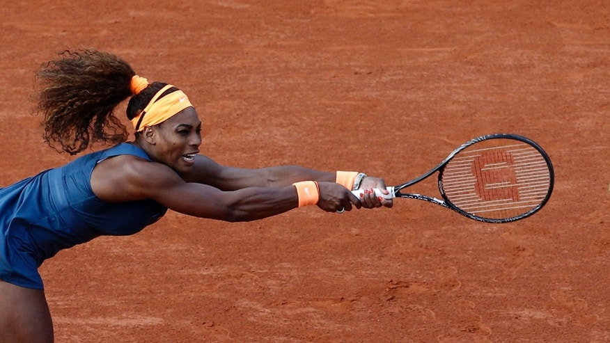 Serena Williams, of the U.S, returns the ball to France's Caroline Garcia during their second round match of the French Open tennis tournament at the Roland Garros stadium Wednesday, May 29, 2013 in Paris. (AP Photo/Christophe Ena)