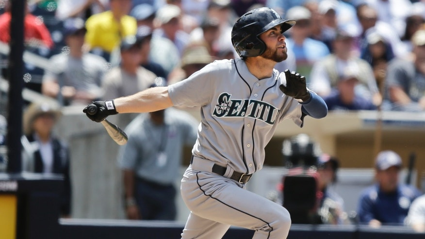 Seattle Mariners' Nick Franklin watches the fight of his first major league career home run in the sixth inning of a baseball game against the San Diego Padres Thursday, May 30, 2013, in San Diego. (AP Photo/Lenny Ignelzi)
