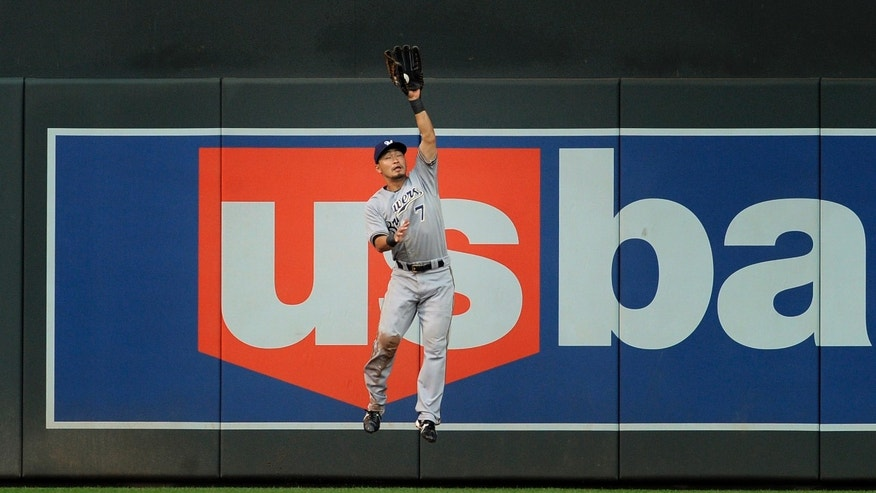 Milwaukee Brewers right fielder Norichika Aoki makes the catch off the bat of Minnesota Twins' Joe Mauer during the first inning of a baseball game on Wednesday, May 29, 2013, in Minneapolis. (AP Photo/Tom Olmscheid)
