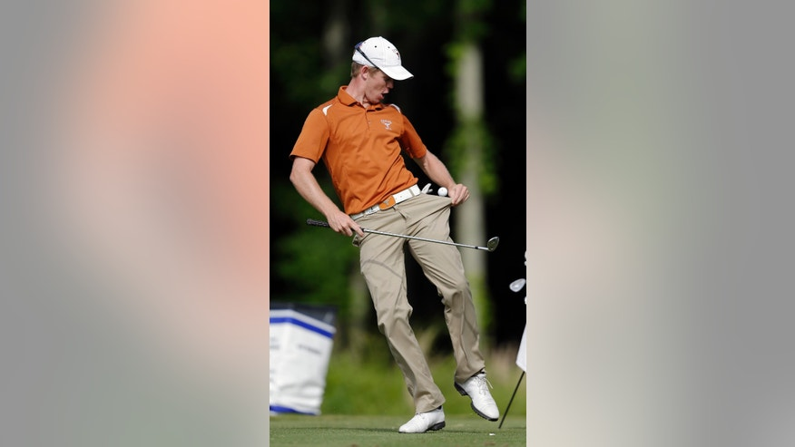 Texas' Brandon Stone catches a ball in his pocket after bouncing it on the head of his club while waiting to tee off on the 16th hole during the NCAA men's golf championship tournament Thursday, May 30, 2013, in Milton, Ga. (AP Photo/John Bazemore)