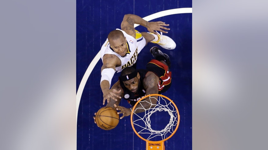 Miami Heat's LeBron James puts up a shot against Indiana Pacers' David West during the first half of Game 4 of the NBA basketball Eastern Conference finals, Tuesday, May 28, 2013, in Indianapolis. (AP Photo/Michael Conroy)
