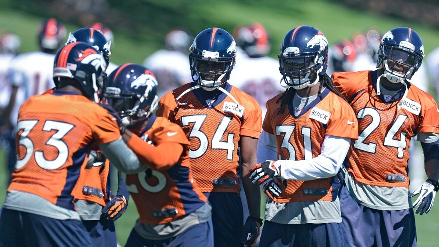 Denver Broncos' Quentin Jammer (34) Omar Bolden (31) and Champ Bailey (24) watch Duke Ihenacho (33) and Rahim Moore (26) run through drills during NFL football practice, Thursday, May 30, 2013, in Englewood, Colo. (AP Photo/The Denver Post, John Leyba) MAGS OUT; TV OUT; INTERNET OUT; NO SALES; NEW YORK POST OUT; NEW YORK DAILY NEWS OUT