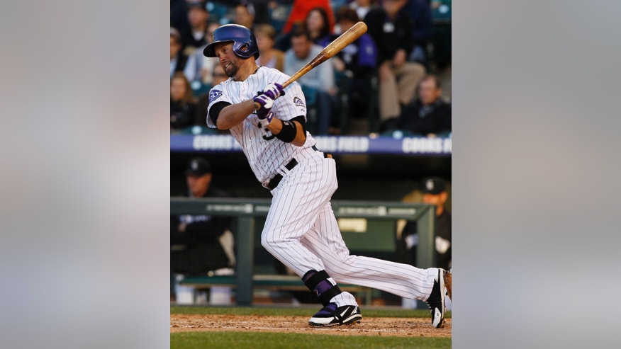 Colorado Rockies' Michael Cuddyer singles against the Houston Astros in the fourth inning of a baseball game in Denver, Wednesday, May 29, 2013. (AP Photo/David Zalubowski)