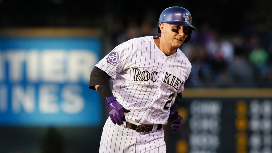 Colorado Rockies' Troy Tulowitzki circles the bases after hitting a solo home run against the Houston Astros to lead off the bottom of the fourth inning of a baseball game in Denver, Wednesday, May 29, 2013. (AP Photo/David Zalubowski)