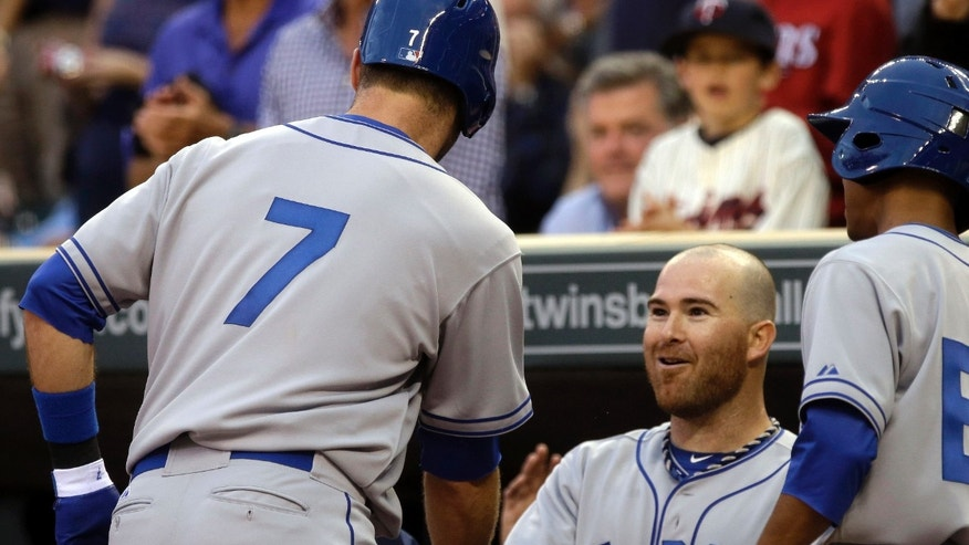 Minnesota Twins' Joe Mauer, left, is welcomed by Ryan Doumit after his solo home run off Milwaukee Brewers pitcher Kyle Lohse in the fourth inning of a baseball game, Thursday, May 30, 2013, in Minneapolis. Doumit followed in the inning with a two-run home run off Lohse. (AP Photo/Jim Mone)