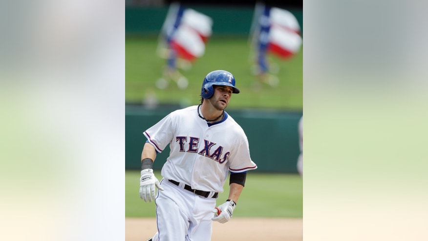 Texas Rangers' Mitch Moreland rounds the bases after hitting a two-run home run during the third inning of a baseball game against the Texas Rangers Thursday, May 30, 2013, in Arlington, Texas. (AP Photo/LM Otero)