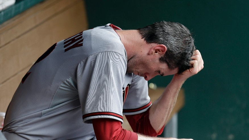 Arizona Diamondbacks starting pitcher Brandon McCarthy sits in the dugout after he was pulled from the baseball game in the fourth inning against the Texas Rangers Thursday, May 30, 2013, in Arlington, Texas. (AP Photo/LM Otero)