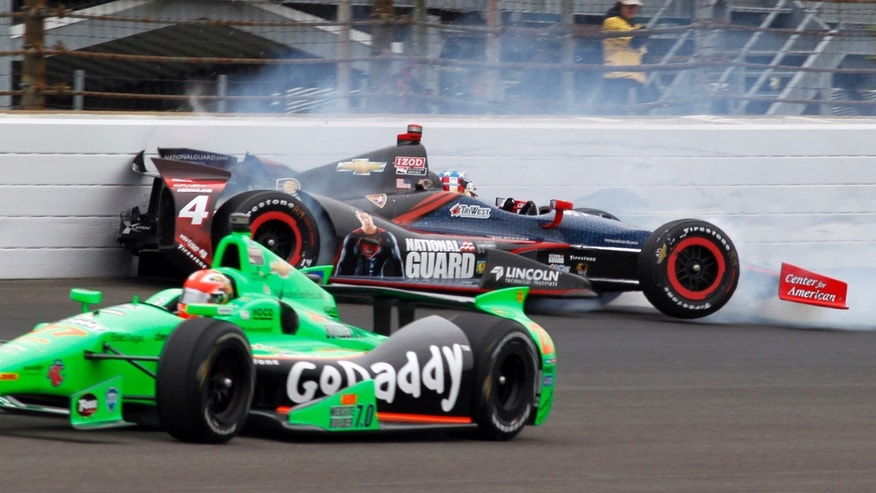 James Hinchcliffe, of Canada, bottom, goes under as JR Hildebrand hits the wall in the first turn during the Indianapolis 500 auto race at the Indianapolis Motor Speedway in Indianapolis Sunday May 26, 2013. (AP Photo/Bill Friel)
