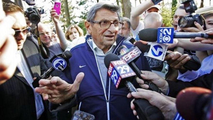 Nov. 8, 2011: Penn State football coach Joe Paterno speaks briefly to reporters as he leaves for football practice in State College, Pa.