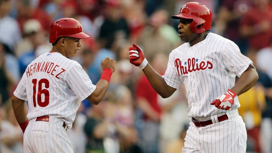 Philadelphia Phillies' Delmon Young, right, celebrates with Cesar Hernandez after Young's two-run home run in the first inning of an interleague baseball game against the Boston Red Sox, Thursday, May 30, 2013, in Philadelphia. (AP Photo/Matt Slocum)