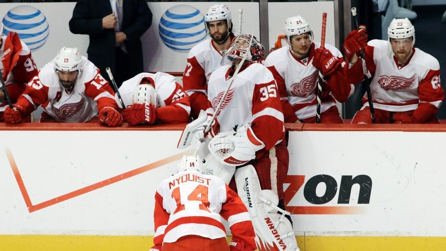 Detroit Red Wings goalie Jimmy Howard (35) and teammates react after the Blackhawks defeated the Red Wings 2-1 in the overtime in Game 7 of the NHL hockey Stanley Cup Western Conference semifinals, Wednesday, May 29, 2013, in Chicago. (AP Photo/Nam Y. Huh)