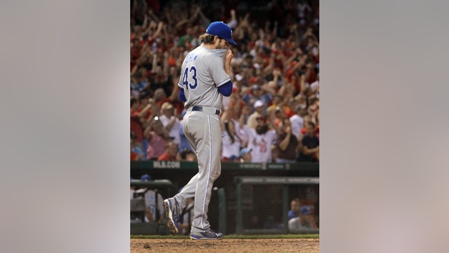 Kansas City Royals relief pitcher Aaron Crow walks back to the mound after giving up a two-run single to St. Louis Cardinals' Daniel Descalso during the eighth inning of a baseball game Wednesday, May 29, 2013, in St. Louis. The Cardinals won 5-3. (AP Photo/Jeff Roberson)
