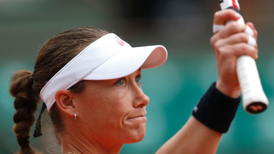 Australia's Samantha Stosur waves after defeating France's Kristina Mladenovic during their second round match of the French Open tennis tournament at the Roland Garros stadium Thursday, May 30, 2013 in Paris. (AP Photo/Petr David Josek)