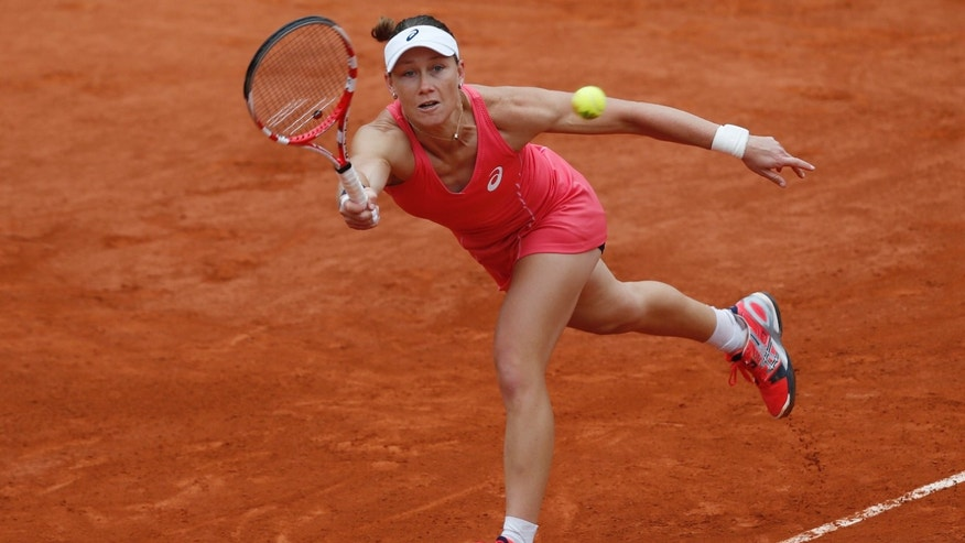 Australia's Samantha Stosur returns against Kristina Mladenovic of France in their second round match of the French Open tennis tournament, at Roland Garros stadium in Paris, Thursday May 30, 2013. (AP Photo/Petr David Josek)