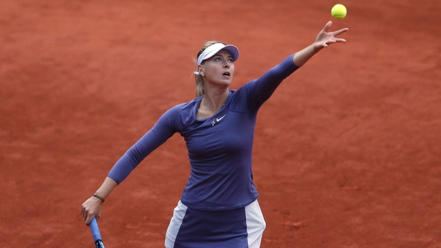 Russia's Maria Sharapova prepares to serve against Canada's Eugenie Bouchard in their second round match at the French Open tennis tournament, at Roland Garros stadium in Paris, Thursday, May 30, 2013. (AP Photo/Petr David Josek)