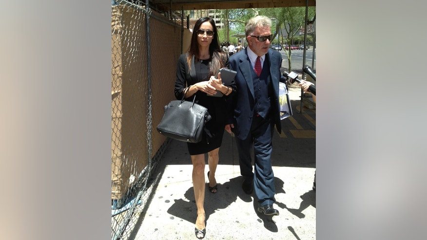 Alejandra Amarilla, ex-wife of Los Angeles Lakers basketball player Steve Nash, walks outside Maricopa County Superior Court in Phoenix with her lawyer, Thursday, May 30, 2013 (AP Photo/The Arizona Republic, Tannott Wilverton)  MARICOPA COUNTY OUT; MAGS OUT; NO SALES   MBO