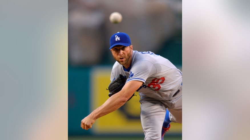 Los Angeles Dodgers starting pitcher Chris Capuano throws to the plate during the first inning of their baseball game against the Los Angeles Angels, Wednesday, May 29, 2013, in Anaheim, Calif. (AP Photo/Mark J. Terrill)
