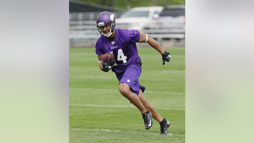 FILE - In this May 29, 2013 file photo, Minnesota Vikings wide receiver Joe Webb goes through passing drills  during team practice in Eden Prairie, Minn. Entering the fourth and final year of his rookie contract, Webb is running out of opportunities to put his elite athleticism to productive use in the NFL. (AP Photo/Jim Mone, File)