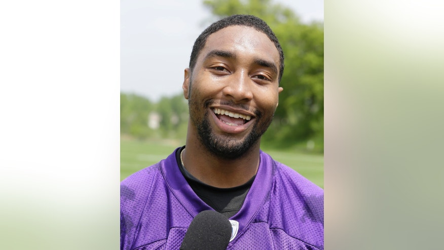 FILE - In this May 29, 2013 file photo, Minnesota Vikings'  Joe Webb talks with reporters after team practice in Eden Prairie, Minn. The Vikings have moved Webb from quarterback to wide receiver, hoping he'll be able to find a niche. (AP Photo/Jim Mone, File)