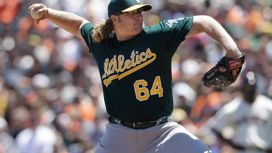 Oakland Athletics pitcher A.J. Griffin (64) throws against the San Francisco Giants during the third inning of a baseball game in San Francisco, Thursday, May 30, 2013. (AP Photo/Jeff Chiu)