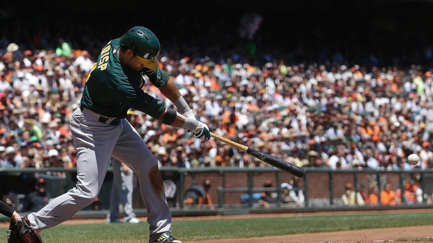 Oakland Athletics' Coco Crisp hits a single to score Derek Norris during the second inning of a baseball game against the San Francisco Giants in San Francisco, Thursday, May 30, 2013. (AP Photo/Jeff Chiu)