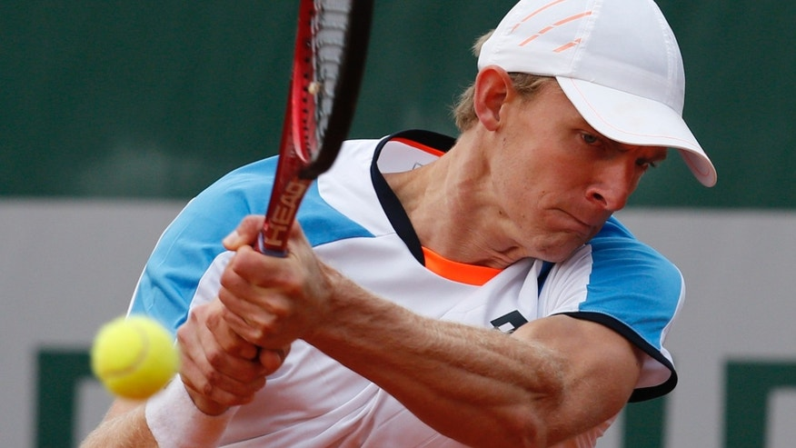 South Africa's Kevin Anderson returns against Canada's Milos Raonic in their third round match at the French Open tennis tournament, at Roland Garros stadium in Paris, Friday, May 31, 2013. (AP Photo/Christophe Ena)