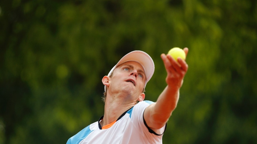 South Africa's Kevin Anderson serves against Canada's Milos Raonic in their third round match at the French Open tennis tournament, at Roland Garros stadium in Paris, Friday, May 31, 2013. (AP Photo/Christophe Ena)