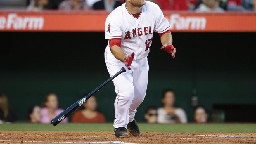 Los Angeles Angels' Chris Iannetta watches his RBI double during the second inning of an interleague baseball game against the Los Angeles Dodgers in Anaheim, Calif., Thursday, May 30, 2013. (AP Photo/Jae C. Hong)