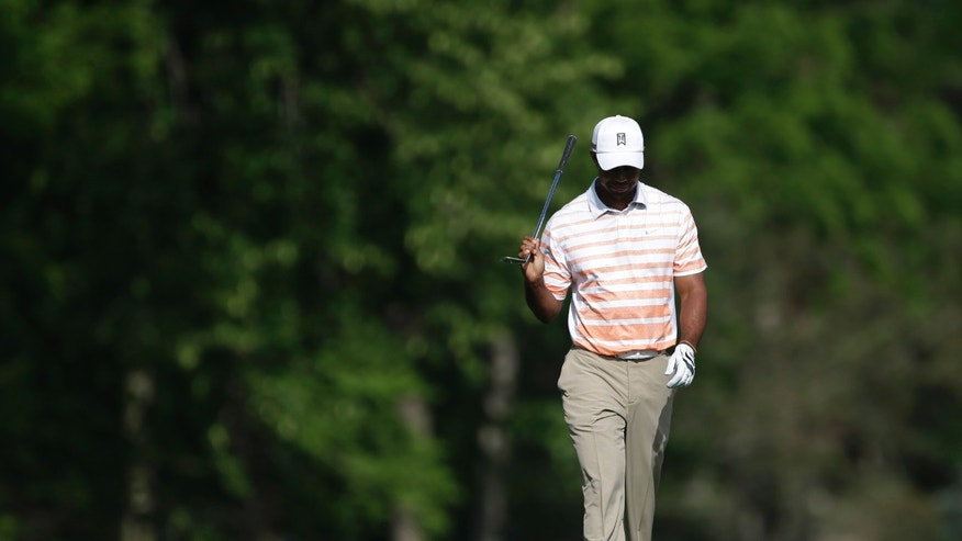 Tiger Woods walks to the 13th green during the second round of the Memorial golf tournament Friday, May 31, 2013, in Dublin, Ohio. (AP Photo/Darron Cummings)