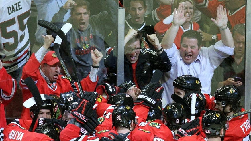 The Chicago Blackhawks celebrate after Brent Seabrook scored in overtime in Game 7 of the NHL hockey Stanley Cup Western Conference semifinals against the Detroit Red Wings, Wednesday, May 29, 2013, in Chicago. The Blackhawks won 2-1. (AP Photo/Daily Herald, Steve Lundy) MANDATORY CREDIT; MAGS OUT; TV OUT