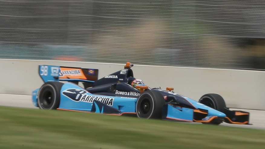 IndyCar driver Alex Tagliani, of Canada, takes turn one during a practice session for the Detroit Grand Prix auto race on Belle Isle in Detroit, Friday, May 31, 2013.  The Detroit Grand Prix will feature IndyCar's first attempt to have a pair of full-length auto races in the same weekend. (AP Photo/Carlos Osorio)