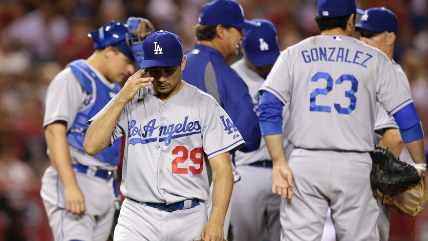 Los Angeles Dodgers starting pitcher Ted Lilly (29) walks off the mound after he was relieved during the sixth inning of an interleague baseball game against the Los Angeles Angels in Anaheim, Calif., Thursday, May 30, 2013. (AP Photo/Jae C. Hong)