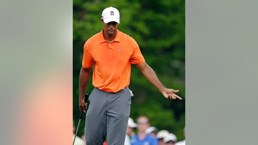 Tiger Woods gestures after missing a putt on the seventh green during the first round of the Memorial golf tournament Thursday, May 30, 2013, in Dublin, Ohio. (AP Photo/Darron Cummings)