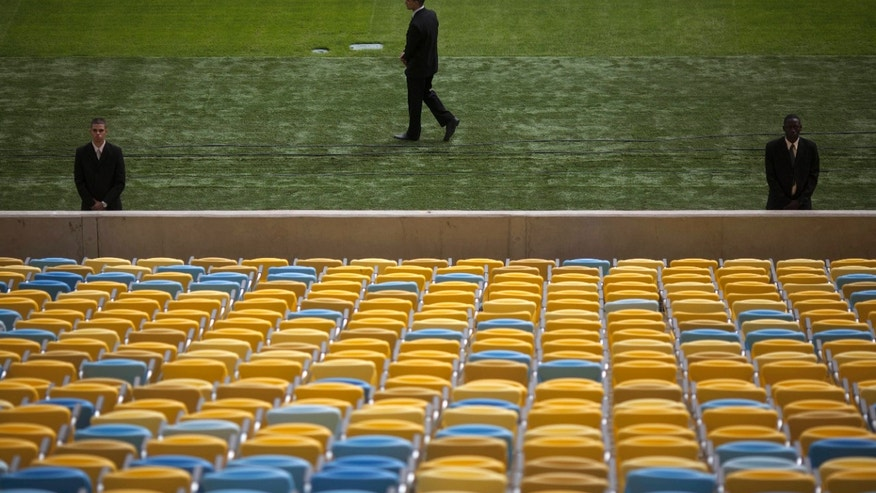 Soldiers take part in a security drill inside Maracana stadium in Rio de Janeiro, Brazil, Wednesday, May 29, 2013. The army conducted the security exercise to prepare for the Confederation Cup soccer tournament that runs from June 15-30. (AP Photo/Felipe Dana)