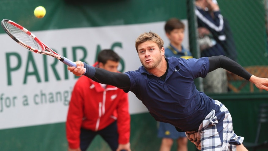 Ryan Harrison of the U.S. returns against compatriot John Isner in their second round match at the French Open tennis tournament, at Roland Garros stadium in Paris, Friday, May 31, 2013. (AP Photo/Michel Euler)