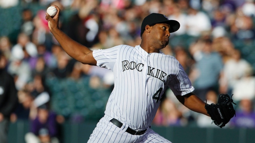 Colorado Rockies starting pitcher Juan Nicasio works against the Houston Astros in the first inning of a baseball game in Denver, Thursday, May 30, 2013. (AP Photo/David Zalubowski)