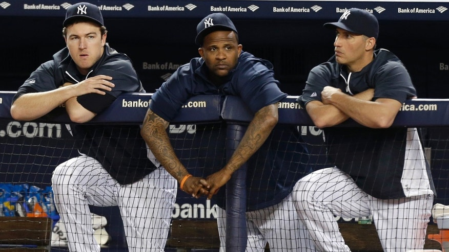 From left, Yankees starting pitchers Phil Hughes, CC Sabathia, and Andy Pettitte watch from the dugout an interleague baseball game against the New York Mets at Yankee Stadium in New York, Thursday, May 30, 2013. (AP Photo/Kathy Willens)