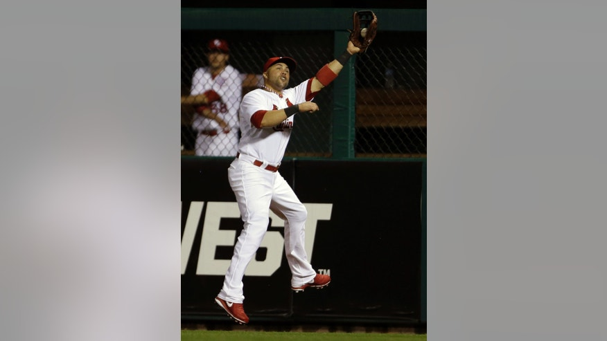St. Louis Cardinals right fielder Carlos Beltran catches a ball hit by Kansas City Royals' Mike Moustakas for an out during the fifth inning of a baseball game on Thursday, May 30, 2013, in St. Louis. (AP Photo/Jeff Roberson)