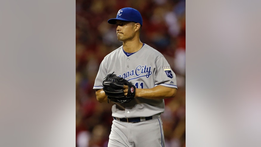 Kansas City Royals starting pitcher Jeremy Guthrie stands on the mound after giving up an RBI-single to St. Louis Cardinals' David Freese during the first inning of a baseball game on Thursday, May 30, 2013, in St. Louis. (AP Photo/Jeff Roberson)