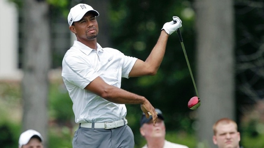 June 1, 2013: Tiger Woods reacts to hitting a bad shot on the ninth hole during the third round of the Memorial golf tournament, in Dublin, Ohio.