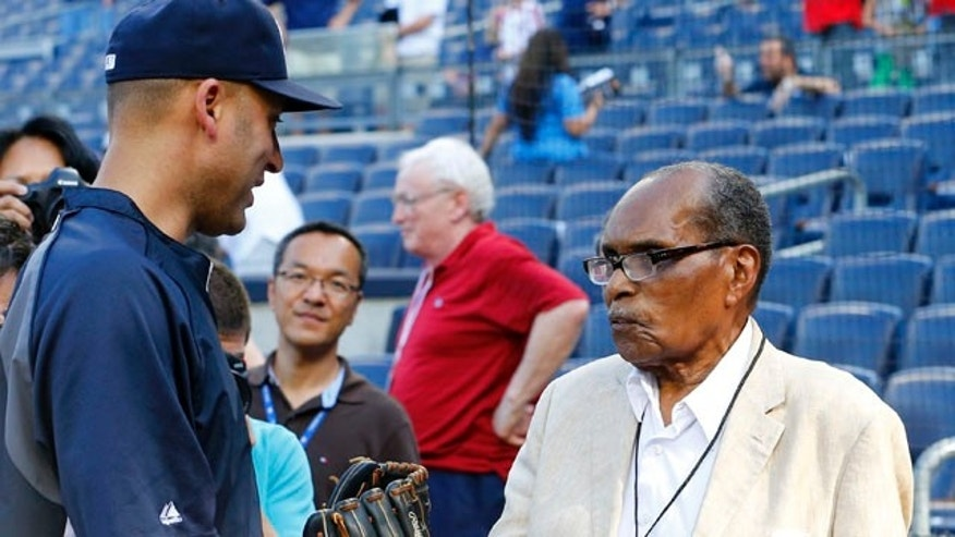June 1, 2013: Bernando LaPallo, right, greets New York Yankees' Derek Jeter during batting practice before a baseball game against the Boston Red Sox at Yankee Stadium in New York.