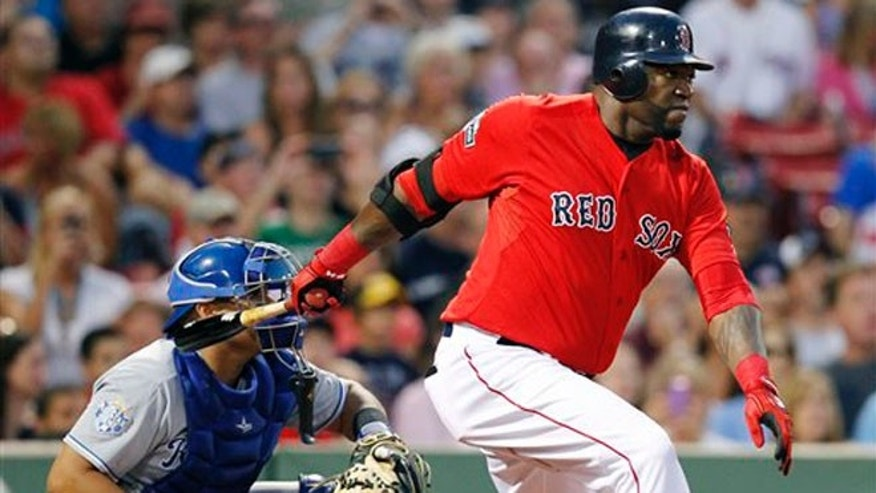 Boston Red Sox's David Ortiz, right, follows through on a two-run single in front of Kansas City Royals' Brayan Pena in the first inning of a baseball game in Boston, Friday, Aug. 24, 2012. (AP Photo/Michael Dwyer)