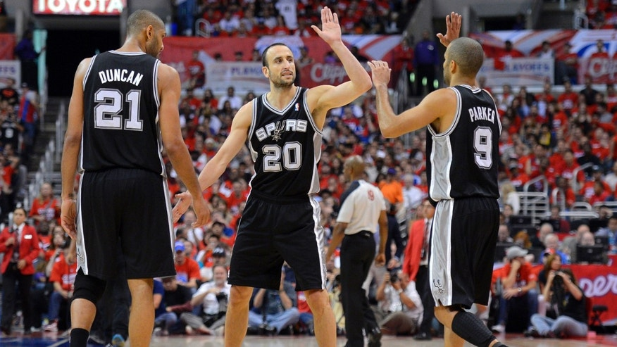 San Antonio Spurs Manu Ginobili celebrates with Tim Duncan, left, and guard Tony Parker of France, in Game 3 of an NBA basketball playoffs Western Conference semifinals against the Los Angeles Clippers in Los Angeles.